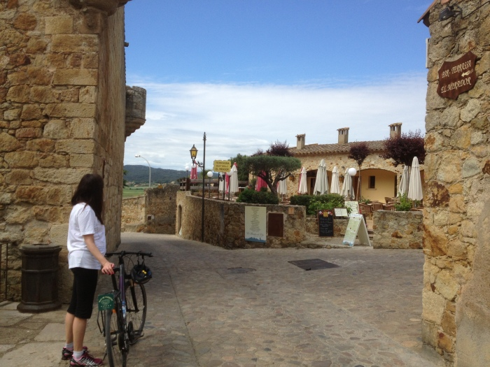 alex biking thru medieval town